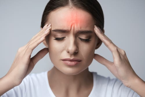 stressed exhausted young woman having strong migraine-img-blog