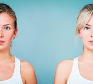 Two Women Standing Side by Side