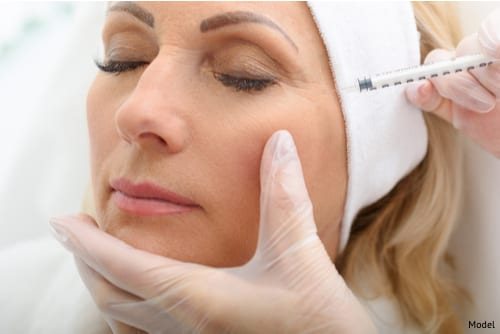 A woman during her injectable filler treatment to erase fine lines and wrinkles.